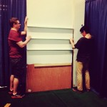 Mr. Moss helping to piece the booth together!